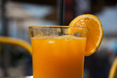 Glass full of fresh squized orange juice Royalty Free Stock Photos