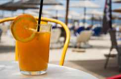 Glass full of fresh squized orange juice Royalty Free Stock Photo