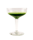 Glass full with green cocktail on a white background Stock Images