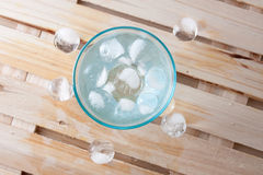 Glass full of pure water with ice balls Stock Image