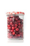 Glass full of red cranberries Royalty Free Stock Images