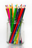 Glass full of sharpened wooden color pencils Royalty Free Stock Images