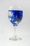Glass full of water with ink color Royalty Free Stock Image