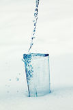 Glass full of water with splashes and bubbles. Glass full of clear water with splashes and bubbles Stock Photography