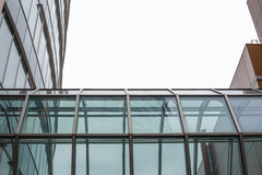 Glass gallery between buildings Royalty Free Stock Images