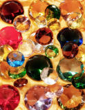 Glass gems. On yellow fabric for sale stock photo
