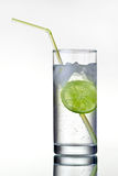 Glass of gin and tonic with ice and lime stock images