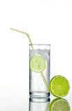 Glass of gin and tonic with ice and lime royalty free stock photography