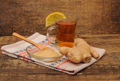 Glass of ginger tea with honey and lemon Stock Photos