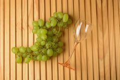 Glass of glass with bunch of grapes Royalty Free Stock Images