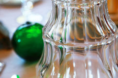 Glass of the glass on the table. Scene of a glass of the glass on the table and the green globe Stock Photo