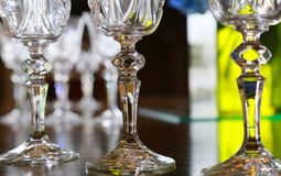 Glass of the glass on the table. The scenery of the crystal glass of the glass and bright green Royalty Free Stock Photos