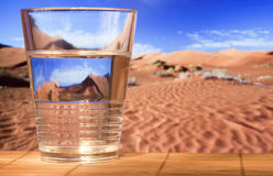 Glass glass with water in desert Royalty Free Stock Photo