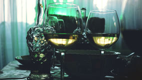 Glass glasses on a table in a restaurant, banquet table, glasses of wine stage green lighting. Glass glasses on a table in a restaurant, banquet table, glasses stock photography