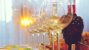 Glass glasses on a table in a restaurant, banquet table, glasses of wine stage lighting Stock Image