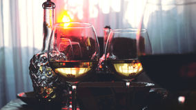 Glass glasses on a table in a restaurant, banquet table, glasses of wine stage yellow lighting. Glass glasses on a table in a restaurant, banquet table, glasses stock photo