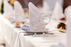 Glass glasses on the table. wine restaurant serving romance beautiful concept alcohol glass, holiday dinner in a cafe royalty free stock photo