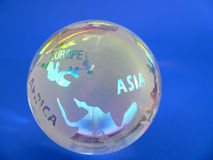 Glass Globe. Globe with Colorful Reflections Stock Photo