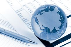 Glass globe. And pen on finance chart Stock Image