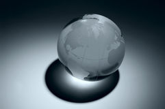 Glass globe. Blue glass earth with shadow and focused lighr Stock Photo