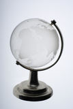 Glass globe against white background Royalty Free Stock Photography