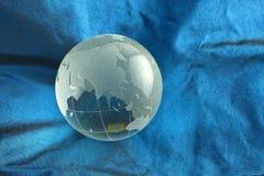 Glass globe, Asia. Glass globe on blue silk background royalty free stock photo