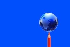 Glass Globe On Blue Stock Photo