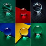 Glass globe or drop of water on a background of colorful paper.Clean and Shine, collage Stock Image