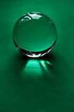 Glass globe or drop of water on a background of green velvet paper.Clean and Shine Stock Photo