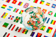 Glass globe on the flags. Of the countries stock images