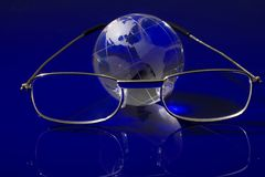 Glass globe with a glasses Stock Photography