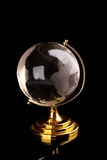 Glass globe with golden base Royalty Free Stock Photos