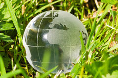 Glass globe in the grass Royalty Free Stock Photos