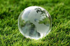 Glass globe in the grass Royalty Free Stock Photo