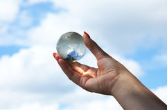 Glass globe in hand Royalty Free Stock Photography