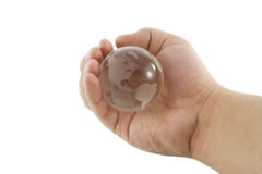 The glass globe in hand. Isolated over white background Stock Images