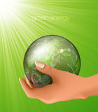 Glass globe in hand. concept of ecology Stock Images