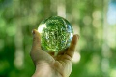 Glass globe in the hand Stock Photo