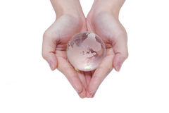 Glass globe in a hand Stock Photography