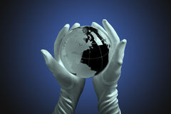 Glass globe in hand with light Stock Photo