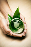 Glass globe in hands Royalty Free Stock Photo