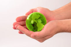 Glass globe in human hand Stock Photo