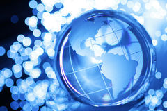 Glass globe in lights. Glass globe in bright blue lights Royalty Free Stock Photography