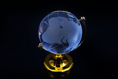Glass globe model gold stand on black table background Royalty Free Stock Photography