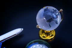 Glass globe model gold stand on black table background Stock Photo