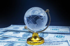 Glass globe model gold stand on black table background Royalty Free Stock Photo