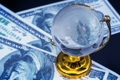 Glass globe model gold stand on black table background Stock Photography
