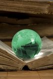 Glass  globe and the old book Royalty Free Stock Photos