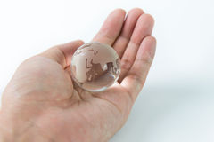 Glass globe in palm Royalty Free Stock Photography