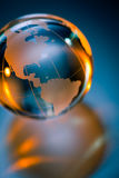 Glass globe of Planet Earth. Reflecting on shiny background Stock Photos